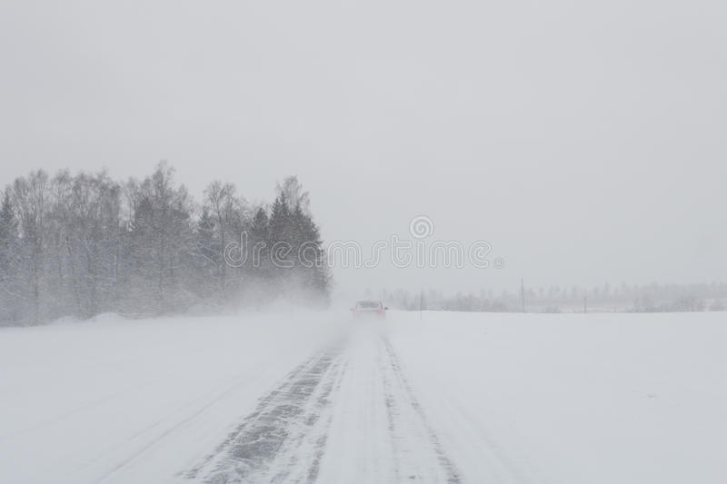Car in a snow storm stock image