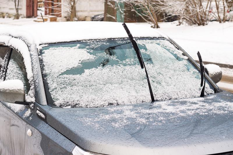 Car in snowdrift. With sticking out so that they do not freeze stock photography