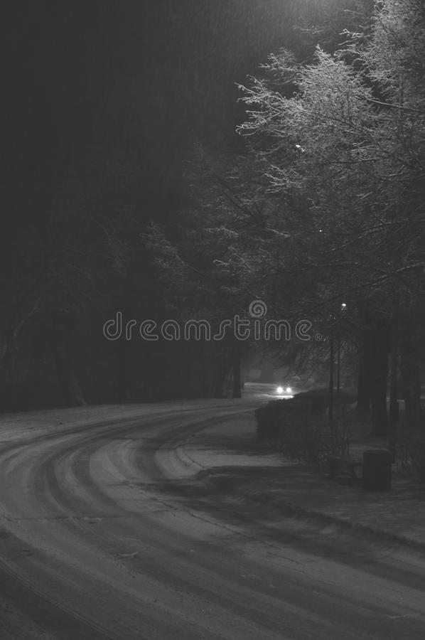 Car on snowy road royalty free stock photo