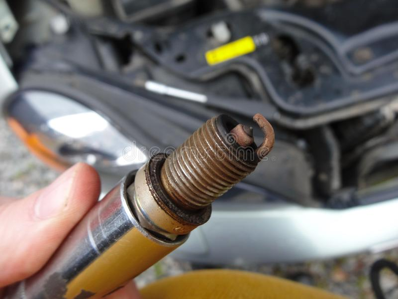 Car spark plugs. Faulty car spark plugs with mileage of over 100,000 km royalty free stock images