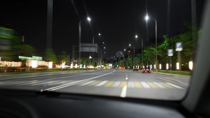 Car speed drive on the road in night stock photo