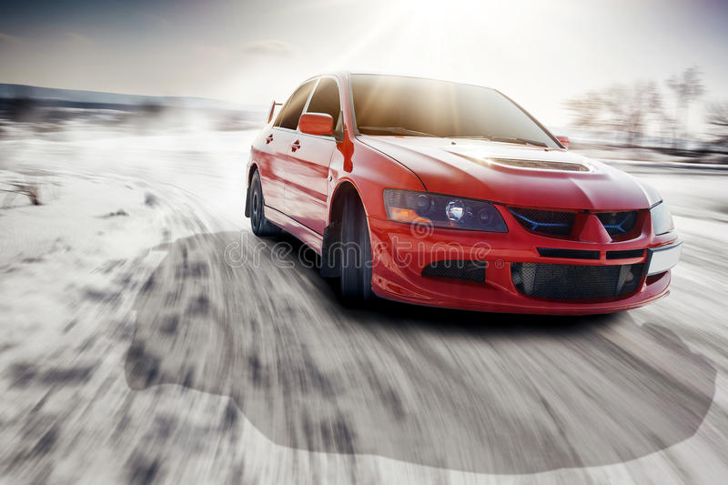 Fast drive car speed on the road turn at winter mitsubishi lancer evolution stock image
