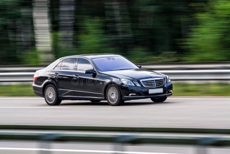 Luxury Mercedes-Benz speeding on empty highway royalty free stock photo