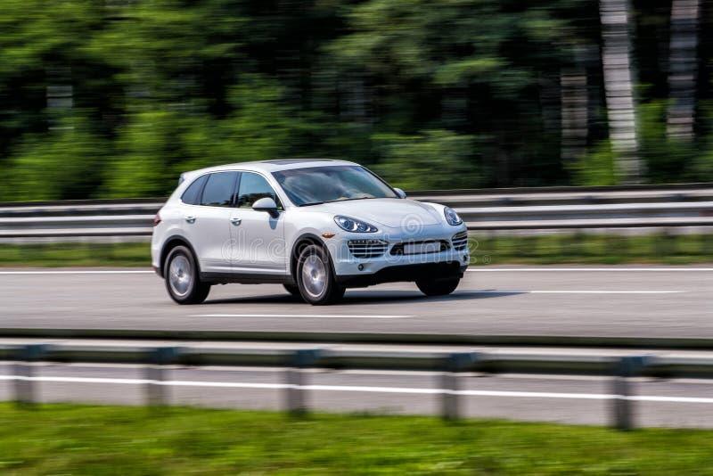 Download Luxury White Porsche Cayenne Speeding On Empty Highway Stock Photo - Image of bumper, background: 54327866