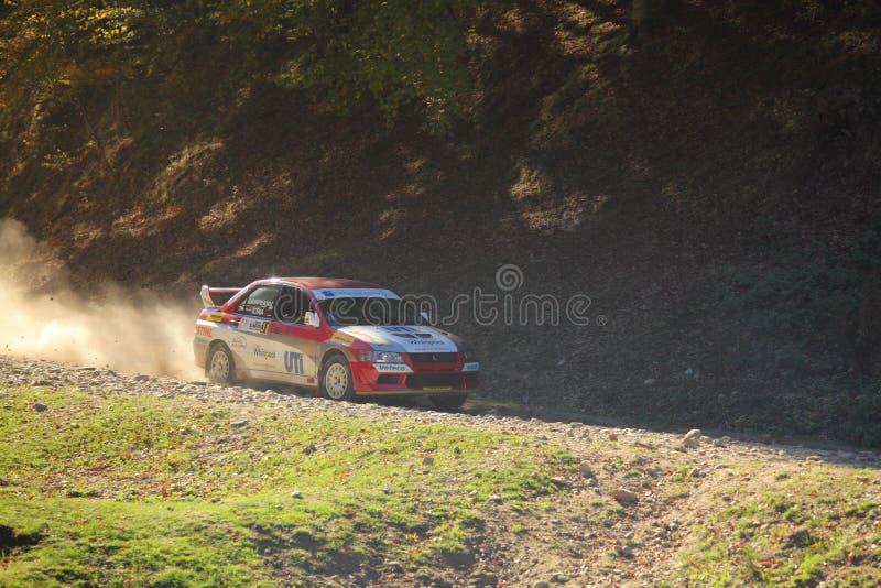 Car speeding on dust gravel stock images