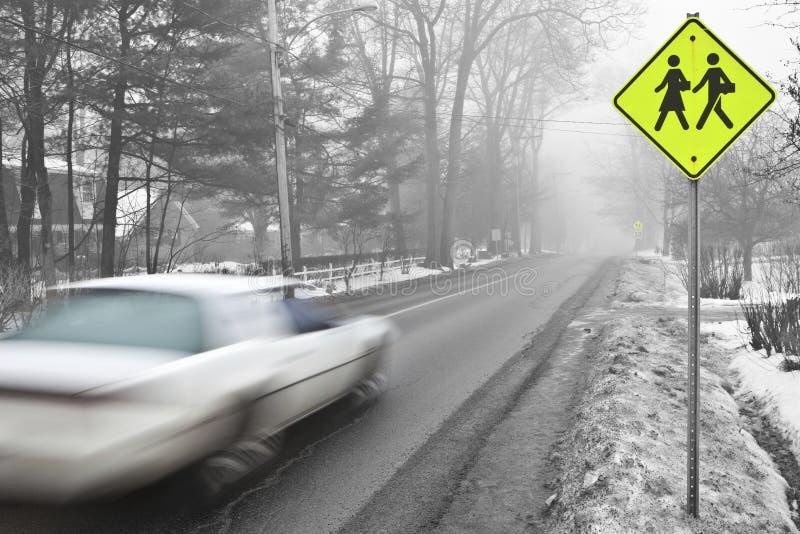 Car speeding in a school zone stock photography