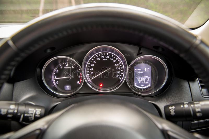 Car speedometer panel.Speedometer of a vehicle.Close up image of car speed dashboard with light illuminated. royalty free stock photos