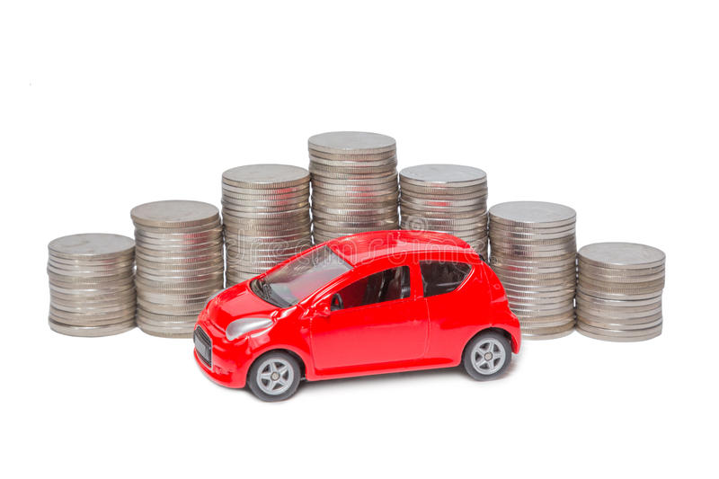 Car and stack of coins isolated on white. Background stock photos