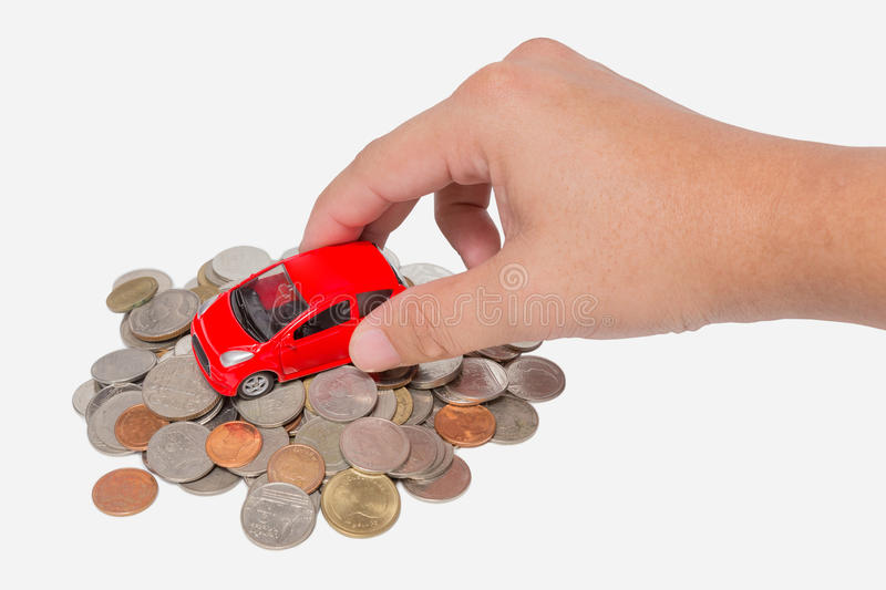 Car stand on a pile of coins. Car with hand stand on a pile of coins isolated on white background stock photos