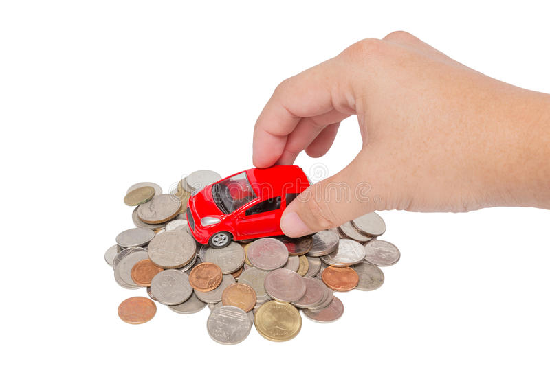 Car stand on a pile of coins. Car with hand stand on a pile of coins isolated on white background stock image