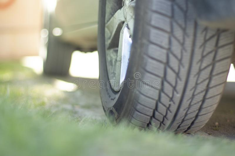 The car stands on the grass bottom view of the wheel royalty free stock image