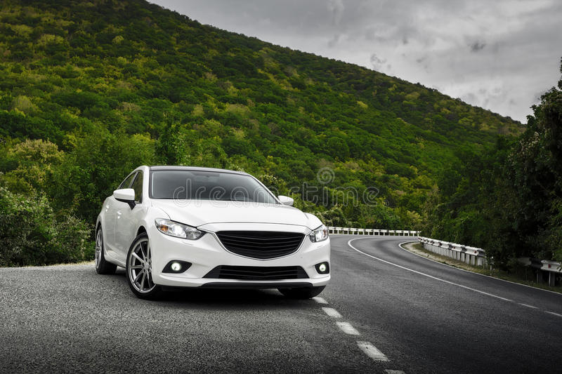 Car staying near a mountain. Car staying on the mountain asphalt road royalty free stock images