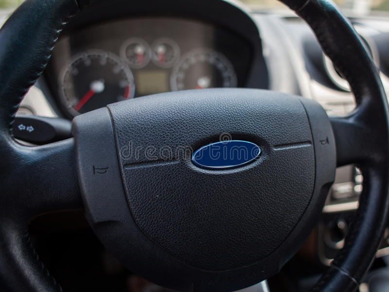 Car steering wheel. With dashboard in background royalty free stock images