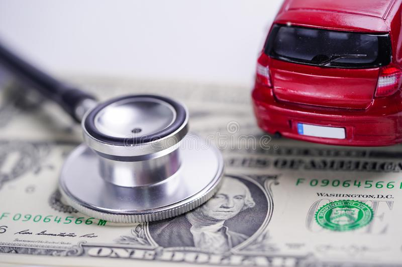 Car, stethoscope and and US Banknotes stock photo