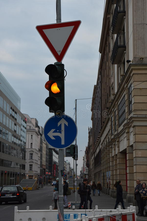 Car street sign, orange light. Cars street signs streets sign walking people royalty free stock photos