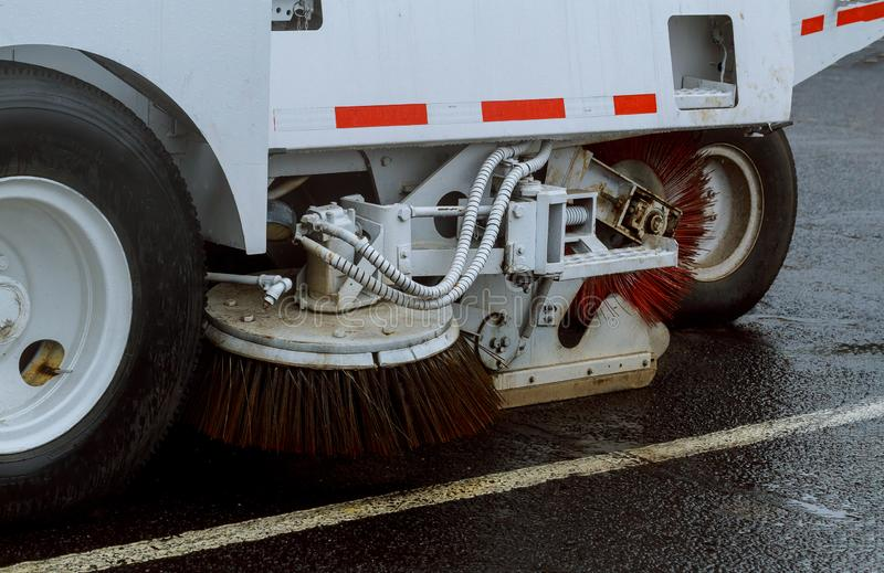 A street sweeper machine cleaning in the road cleaning asphalt. Car street sweeper machine cleaning in the road cleaning asphalt vehicle city equipment brush stock photography