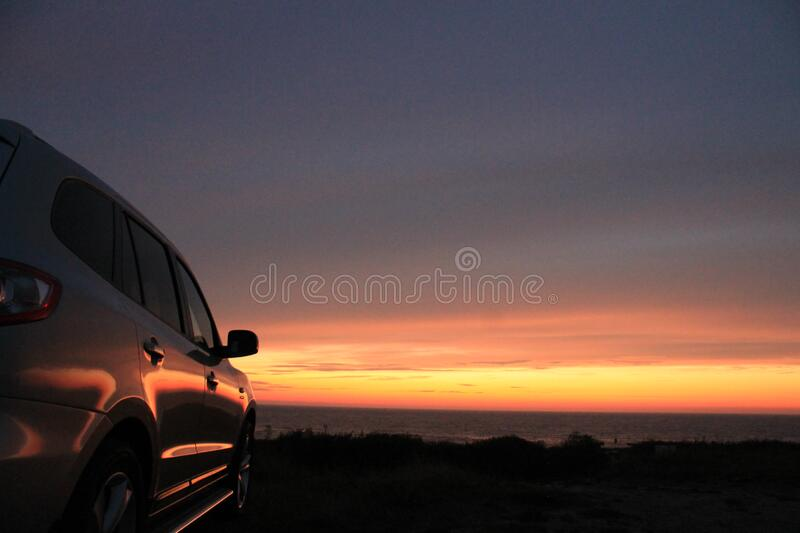 Car at sunset royalty free stock images