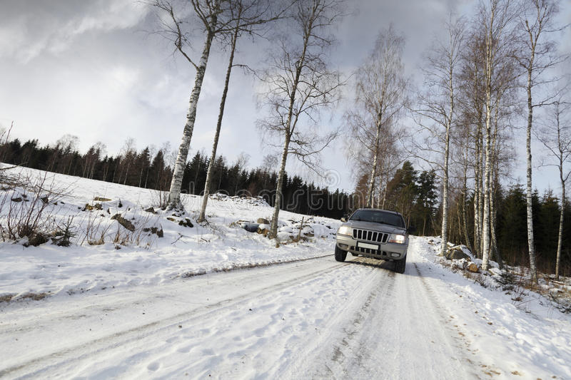Download Car, Suv, Driving On Snowy Road Royalty Free Stock Image - Image: 23178656