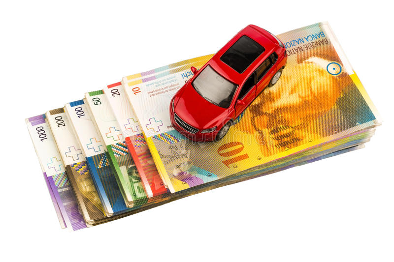 Car on swiss franc. A car is swiss franc banknotes. costs for the purchase of automobiles, gasoline, insurance and other car costs stock image