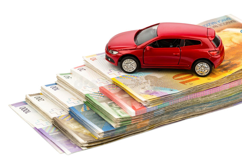 Car swiss franc. A car is swiss franc banknotes. costs for the purchase of automobiles, gasoline, insurance and other car costs royalty free stock photography