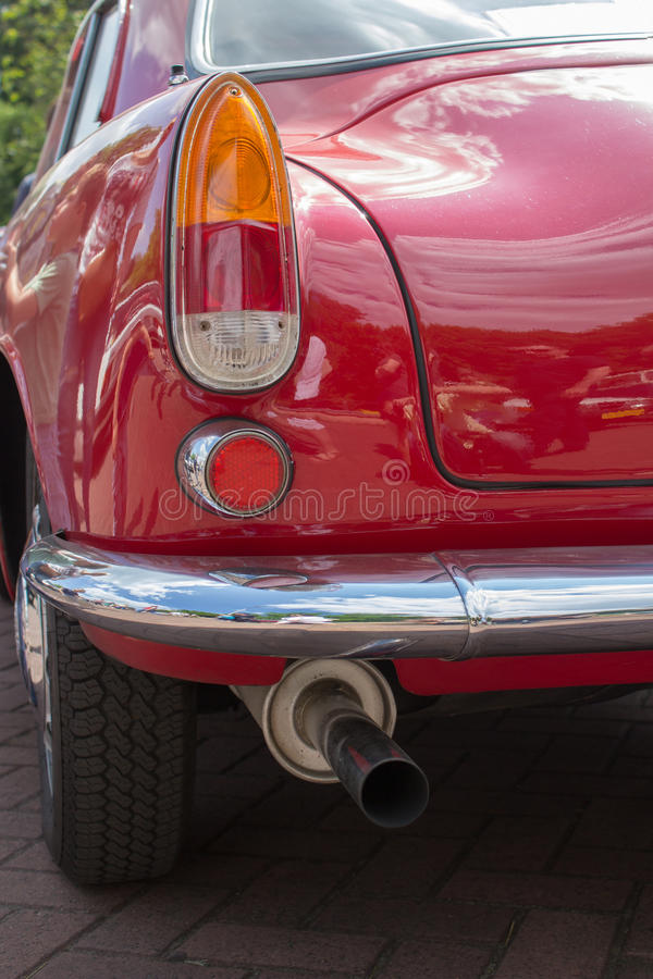 Car taillight. A taillight on the rear of a vintage automobile stock photos