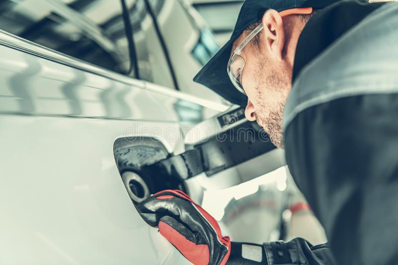 Car Tank Gasket Problem. Auto Service Technician Looking For Potential Issues with Vehicle Fueling stock photography