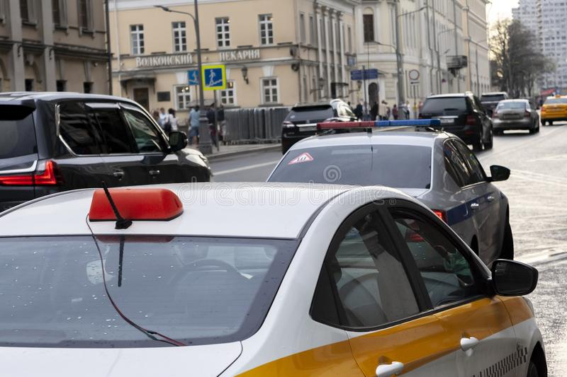 The car of the taxi was stopped by police officers on the city street. MOSCOW,RUSSIA-MAY 04 2018 :the car of the taxi was stopped by police officers on the city stock photography