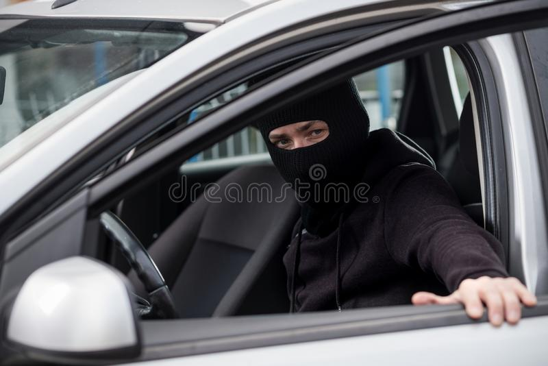 Car Thief gets into a stolen car royalty free stock image