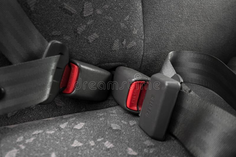 Car three-point safety belt, buttoned, the concept of road safety, life and health of the driver and passengers. Compliance with traffic rules stock image