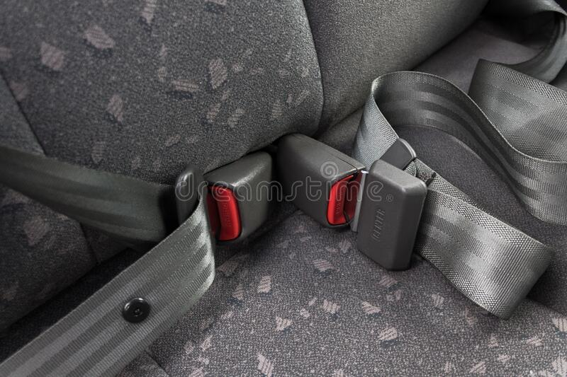 Car three-point safety belt, buttoned, the concept of road safety, life and health of the driver and passengers. Compliance with traffic rules royalty free stock images