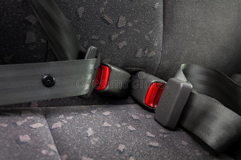 Car three-point safety belt, buttoned, the concept of road safety, life and health of the driver and passengers. Compliance with traffic rules royalty free stock photography