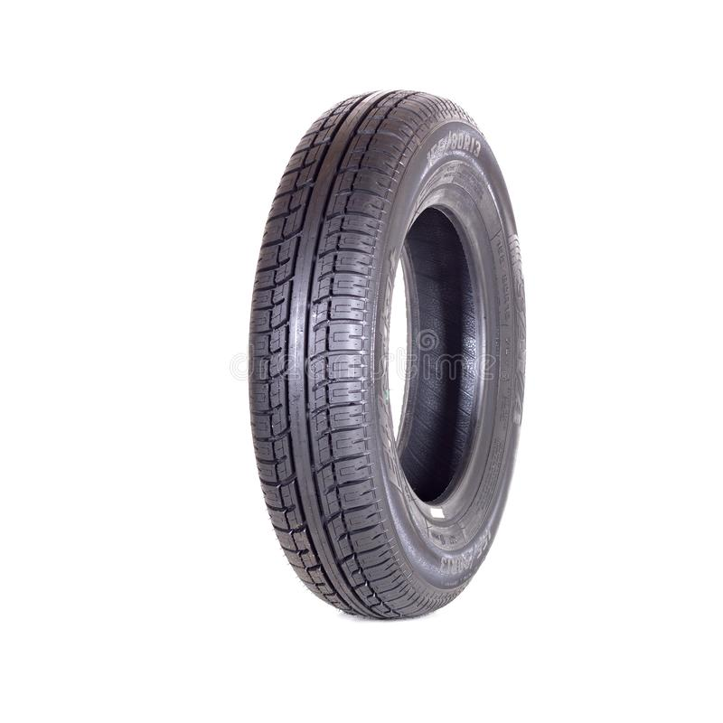 Car tire, new tyre Goodyear Dunlop Sava on white background isolated close up royalty free stock photography