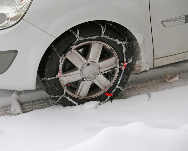 Car tire with snow chains in winter stock photos