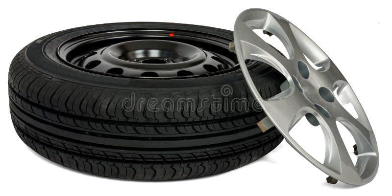 Car tire with wheel cap. White background stock photos