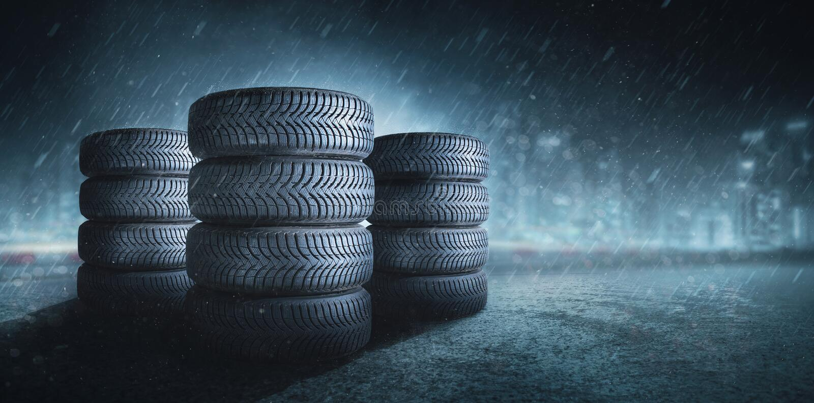 Car tires on a rain road stock photo