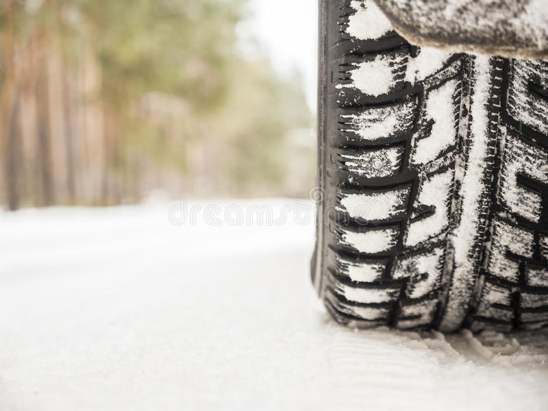 Car tires on winter road stock image