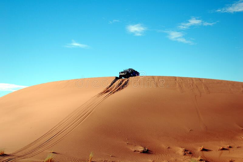 Car on Top of Sand Cliff during Day Time royalty free stock image