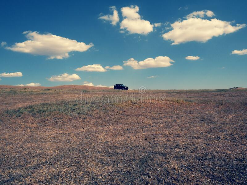 Car on top of steppe hill in Georgia country royalty free stock image