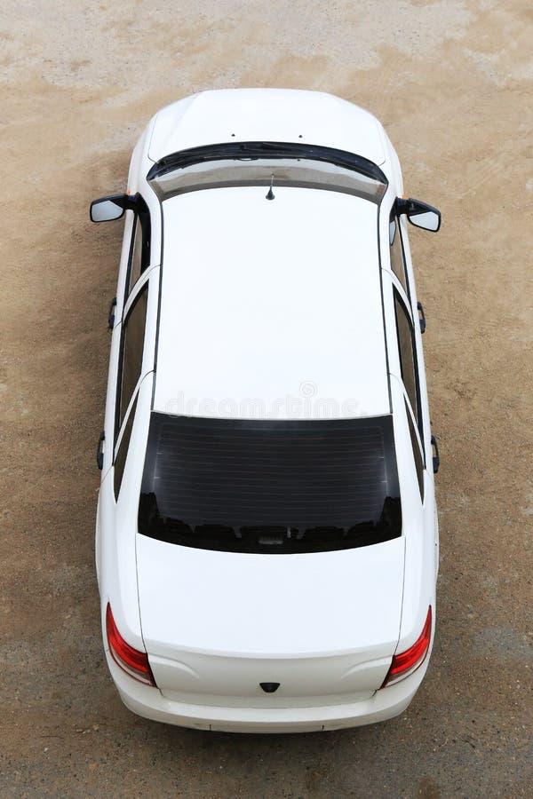 Car top view. White modern car top view stock photo