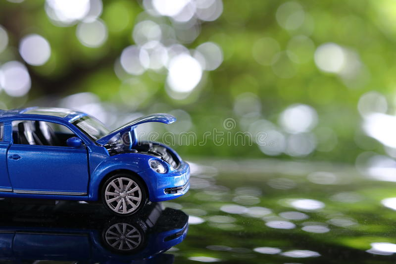 Car toy problem broken down parked with open hood of vehicle. Miniature car toy problem broken down parked with open hood of vehicle waiting for repair service stock photo
