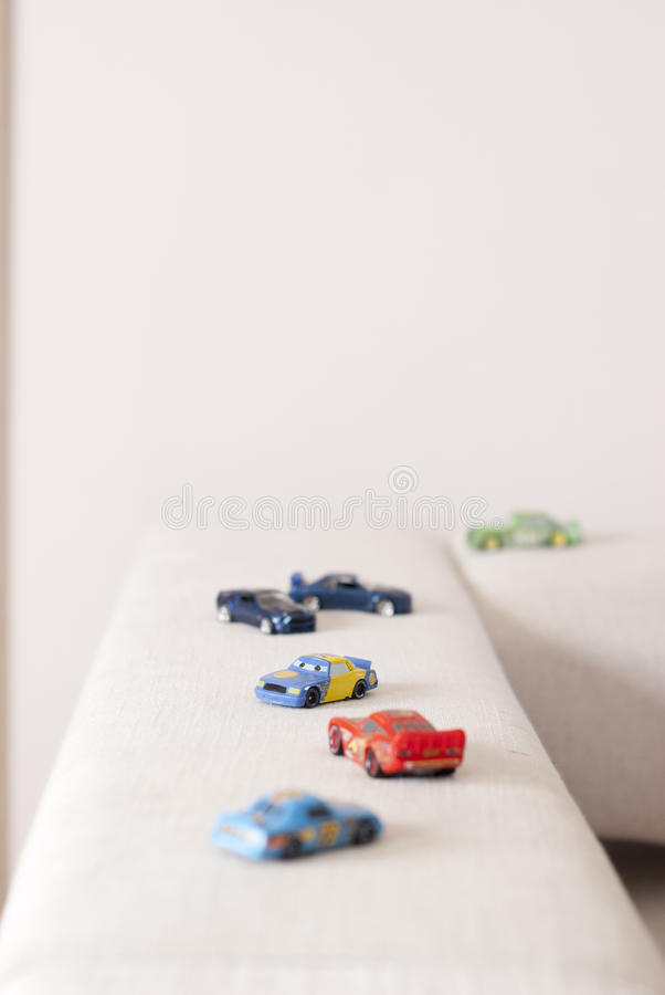 Car toys on a sofa stock images
