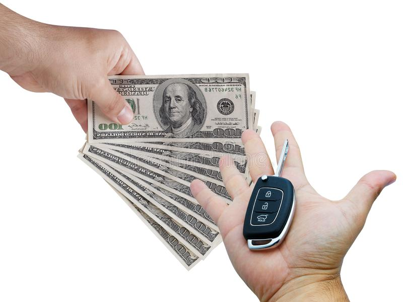 Car trading concept. Male hands buying and selling money dollar bills key car isolated. On white stock photography