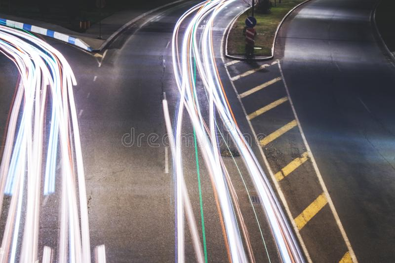 Car traffic in a city at night time. stock photography