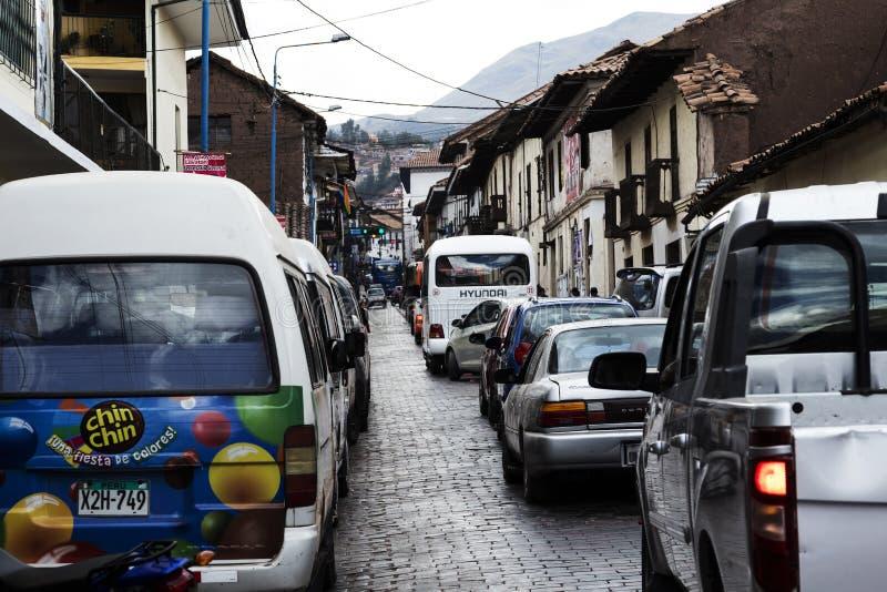 Car Traffic On Narrow Street Cusco Peru South America. Cusco, Peru - June 15, 2015: Cars And Bus On Brick Paved Street Cusco Peru South America With Buildings royalty free stock photo
