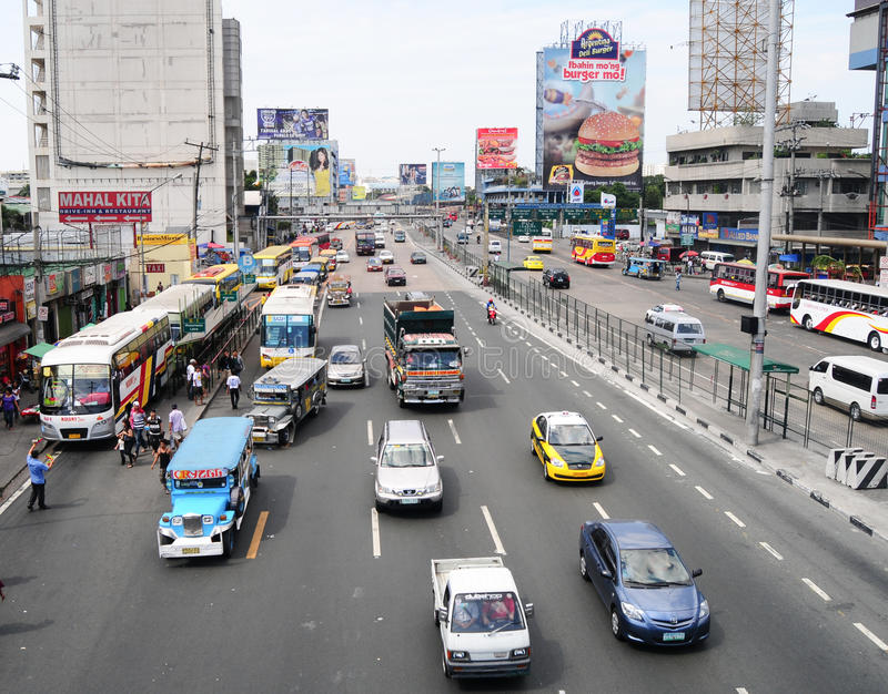 Car traffic on the streets in Manila. MANILA, PHILIPPINES - SEPTEMBER 8, 2014. Car traffic on the streets of Intramuros district, oldest district and historic stock photo
