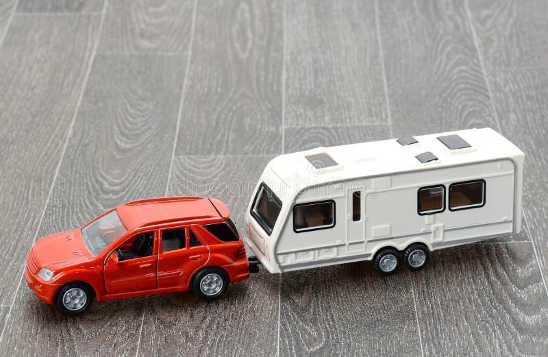 Car and trailer caravan. Car and a trailer caravan - travel concept. Studio shot royalty free stock photography