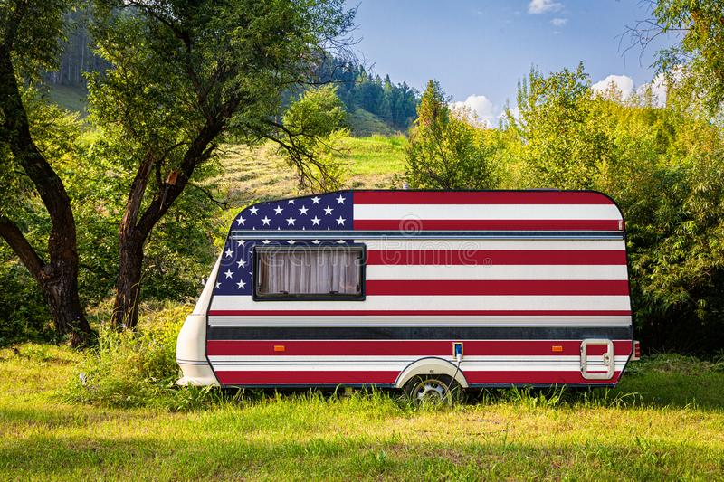 A car trailer, a motor home, painted in the national flag stock photo