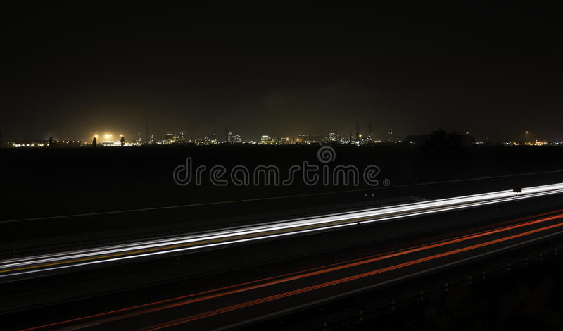 Car trails with an industrial plant. On the background stock photo