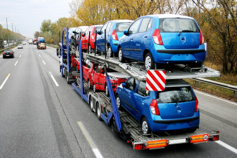 Car lorry. Lorry transporting cars along motorway stock photography