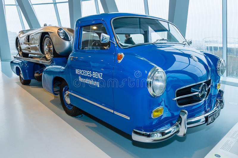 Car transporter Mercedes-Benz and sports car Mercedes-Benz 300 SLR. STUTTGART, GERMANY- MARCH 19, 2016: The high-speed racing car transporter Mercedes-Benz (Blue royalty free stock photos
